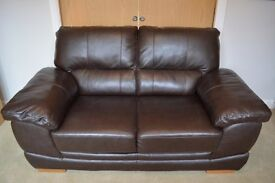 Real leather brown sofa 2 seater good condition hardly used