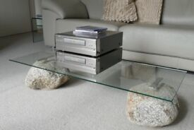 Low glass topped table, with stone base. Approximate h. 22cm x l. 101cm x d. 40cm. Stone Circ 33cm