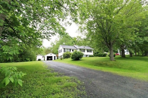 AFFORDABLE BUNGALOW ON COUNTRY LOT WITH GARAGE