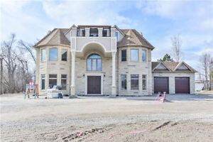 ABSOLUTELY STUNNING CUSTOM BUILT HOME WITH OVER 5000 SQFT