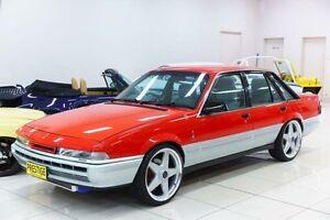 1987 Holden Commodore VL Berlina Red 5 Sp Manual Sedan Carss Park Kogarah Area Preview