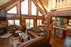 Waterfront Log Home in Long Sault