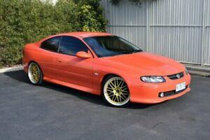2002 Holden Monaro V2 CV8 Orange 6 Speed Manual Coupe Devonport Devonport Area Preview
