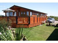 timber holiday lodge sited on a park that is open 12 months. 18 hole golf course, all tides slip way