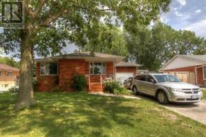 Brick Bungalow Convenient Location     $155,000