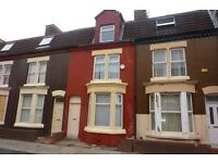 1/2 Price first months rent on four bedroom mid three storey terrace property located in Anfield