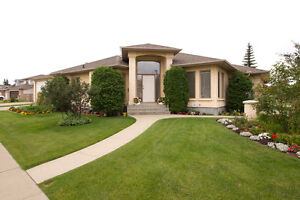 SCHMIDT REALTY GROUP - Show Home in prestigious Twin Brooks
