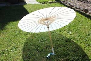 four white silk and bamboo parasols Capital Hill South Canberra Preview