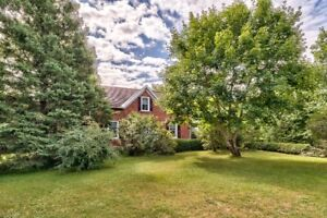 Lovely Century Brick Home on 203 Acres