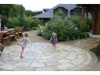 MINT NATURAL SANDSTONE PAVING SLABS (SOLID STONE) RANDOM PATTERN - FEATURE CIRCLES AND COBBLES ALSO
