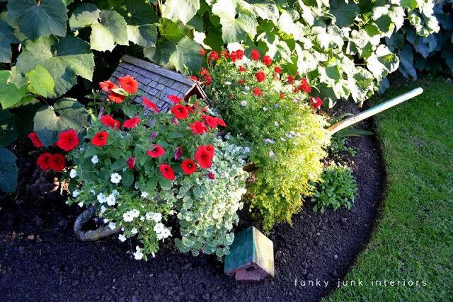 1. Wheelbarrow planter / 10 garden junk art ideas to jazz up your yard! By Funky Junk Interiors for ebay.com
