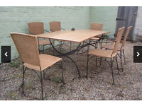 INDOOR Solid wooden dining table and 6 wicker chairs