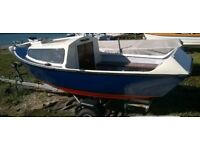 Fishing boat...15 ft x 5 ft , and Road Trailer.Very Stable. Recently repainted