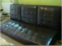 Brown leather sofa-bed double size