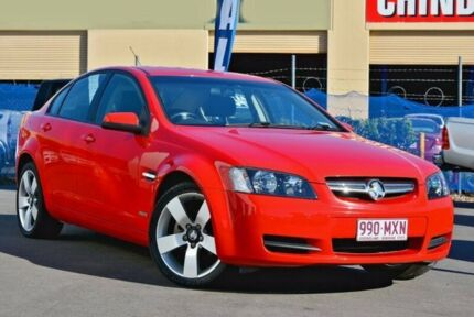 2010 Holden Commodore Red Sports Automatic Sedan