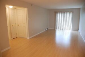 2 Balconies (Parking for 2 cars) (2 bedrooms at each end of apt)