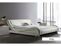 Double faux leather bedstead (new) excludes matress