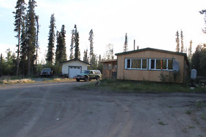 House for Sale in Teslin - Great Investment Opportunity!