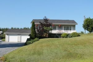 Meticulously maintained bungalow with attached double garage!