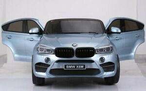 2 seater Lexus/Bmw x6 official ride on car for kids with RC