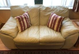 Like new leather sofa with footstall