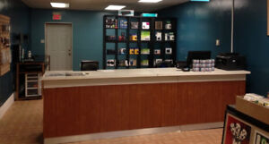 Retail counter - wood and white laminate - 11ft long, wired