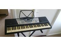 Portable electric keyboard