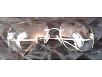 Chanel reactalight glasses with case, cleaning cloth and instructions