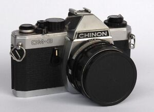 CHINON (Kodak) CE3 or PENTAX K1000 with a 50mm or 28mm lens