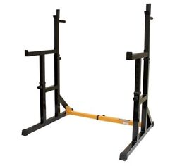 Half rack frame with heavy adjustable bench and olympic weight tree! £80.