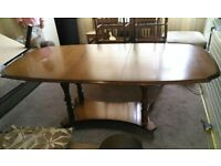 extending dining table with 5 chairs red / black