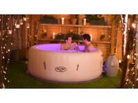 Lazy Spa Paris with LED's, floor protector, drinks holders and chemicals.