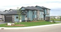 1654 sq' custom built & fully permitted 1000 sq.' basement suite