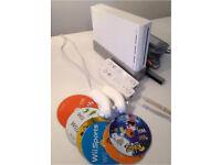 Intendi Wii + 2 remotes + 2 nunchucks + 6 disks great value!