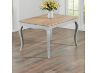 Brand new Beremboke dining table, solid oak, grey sides and legs.