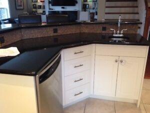 Black granite countertop with white cabinets for sale