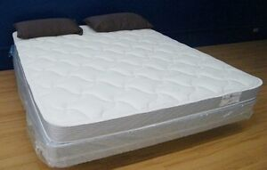 Brand new king mattress with matching box springs