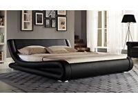 Striking 4ft6 double curved black leather bed frame, in box with mattress, free delivery