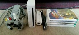 Nintendo Wii console + 4 games