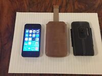 iPhone 4 with 28 gig capacity plus two leather cases - all three in excellent condition