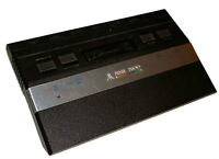 ATARI 2600 system and 8 games with 2 controllers