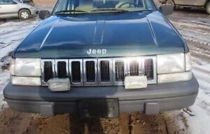 1993-1998 Jeep Grand Cherokee headlights assembly- both sides