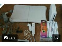 wii console with controller, fit board and 7 games