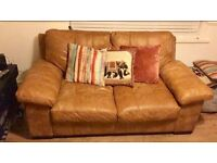 Nearly new! Western leather 2 seater sofa, arm chair and foot stool