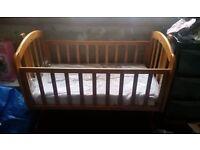 Brown oak swinging crib & Brown oak cot bed
