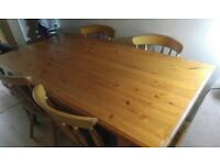 Lovely Solid pine farmhouse dining table with 6 traditional chairs!