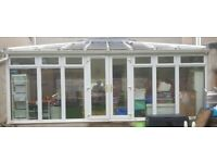 Large White conservatory doors,windows and roof