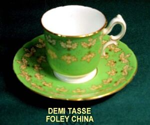 DEMI TASSES AND SAUCERS