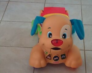 Fisher Price Dog ride on toy, plays music