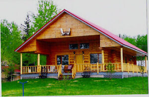 Beautiful lake front Log Home on 1/2 acre lot